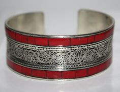 This is one size adjustable cuff Bracelet is made of White metal, and Coral. This is handcrafted by local artisan from Kathmandu, Nepal. The bracelet