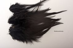 Hey, I found this really awesome Etsy listing at https://www.etsy.com/listing/97657789/black-feathers-dyed-black-rooster