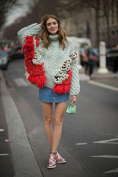 45 Street Style Inspired Ways to Wear a Mini Skirt Through Fall - Chira Ferragni wearing a chunky statement turtleneck sweater styled with a denim mini skirt and pink metallic flat sandals