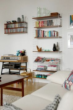 'String' shelving system for magazines in dinning area