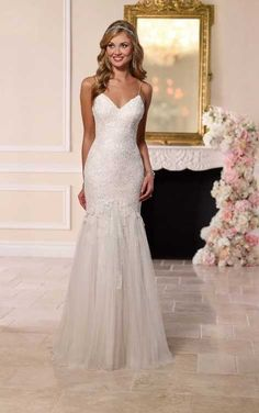 This dramatic, yet elegant, lace and tulle over Lustre satin wedding gown from Stella York features sexy spaghetti straps, a sweetheart bodice fitted to just below the hips, and an eye-catching tulle and lace layered train. The back has an easy-close zipp Wedding Dress Low Back, Spaghetti Strap Wedding Dress, Lace Wedding Dress, Fit And Flare Wedding Dress, 2016 Wedding Dresses, Custom Wedding Dress, Bridal Dresses, Wedding Gowns, Lace Dress