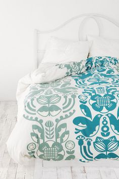 Love the turqouise and moss (?) color scheme. Bedding at Urban Outfitters for $19.99.