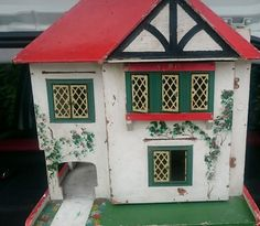 VINTAGE  DOLLS HOUSE Triang? with vintage furniture