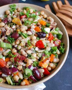 Mediterranean Bean Salad packs chickpeas, white beans, your favorite Mediterranean vegetables and feta cheese into one healthy salad and is topped with a light lemony dressing. This works perfectly as a side dish to a meal or even as lunch with pita bread and hummus. // A Cedar Spoon