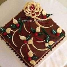 Chocolate sponge cake with Baileys syrup decorated with edible hand designed chocolate white/red rose, leaves & berries http://www.facebook.com/R77aga