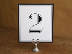 Black and white table numbers that are stunning and easy to make. Enter table numbers into the editable PDF template, print, fold and cut. Make a dozen in under 15 minutes.
