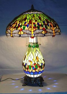 <br>This elegant Yellow Dragonfly Table Lamp has been handcrafted using methods first developed by Louis Comfort Tiffany. <ul><li>Shade contains hand-cut pieces of stained glass wrapped in fine ...