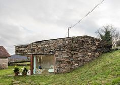 Cubus Arquitectura has transformed an old stone wine cellar in Galicia, Spain, into a family home