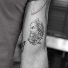 small Zeus tattoo idea on arm by mr.k_tattoo