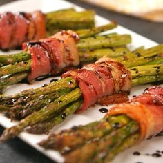 Bacon-Wrapped Asparagus- Bacon-Wrapped Asparagus Easy elegant appetizer to make your next dinner party extra fancy: crispy roasted asparagus spears bundled in bacon and drizzled with honey balsamic glaze. Easy Asparagus Recipes, Bacon Wrapped Asparagus, How To Cook Asparagus, Asparagus Spears, Grilled Asparagus, Gourmet Recipes, Cooking Recipes, Appetizer Recipes, Healthy Recipes