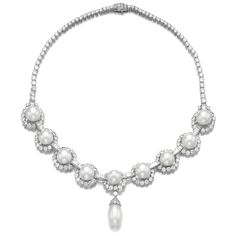Cultured pearl and diamond pendent necklace, Van Cleef & Arpels. Designed as a slightly graduated line of brilliant-cut diamonds, accented by nine button shaped cultured pearls, framed with similarly cut stones and connected by baguette diamonds, suspending a detachable cultured pearl drop.