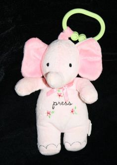"The sweetest little Carter's Elephant  with Flower Press tummy.  Soft Plush Pink Musical Light Up cheeks and plays Rock A Bye Baby tune soft Toy about 8"" #Carters"