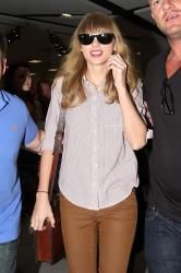Trying to look normal it won't work for Taylor Swift!