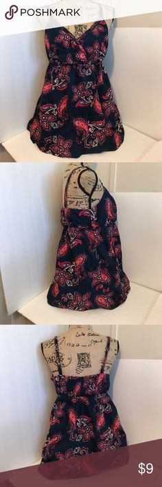 Faded Glory Flowy Tank Top Size L (12-14) This is a Faded Glory Flowy Tank Top Size L (12-14). In good pre-owned condition! This top is very flowy and tends to be closer to a XL size. Faded Glory Tops Tank Tops