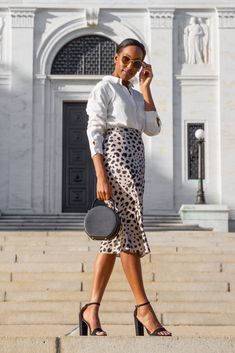 4f286bf15a Leopard skirt black heels spring fashion #TheStoriedLife Spring Outfits  Lana Jackson DC Stylist The Storied Life Blog DC Blogger Ann Taylor Cateye  ...