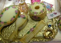 Take a Chrysonbon vanity set, misc. jewelry findings and stones, paints and printed articles and make a gorgeous filled vanity.