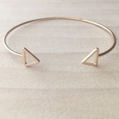 Gold Triangle Bangle Brand new adjustable bangle. Same day or next day shipping. No trades and no holds. 20% off bundles. Jewelry Bracelets