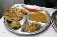 Paranthe Wali Gali – Delhi's World Famous Back Street of Deep Fried Bread - Slotted in the ancient narrow alleys of Delhi, India, is the legendary series of restaurants serving North Indian parathas; The lane is famously known as Paranthe Wali Gali.