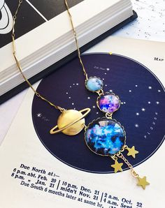 Many Worlds Multiverse Necklace – [pin_pinter_full_name] Many Worlds Multiverse Necklace The multiverse. It's a huge concept to wrap your head around (whichever universe you're in) … Galaxy Jewelry, Moon Jewelry, Cute Jewelry, Jewelry Accessories, Jewelry Design, World Necklace, Crystal Necklace, Pendant Necklace, Unicorn Necklace