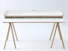 Doppeldecker Table is a minimal design created by Netherlands-based designers Bernotat The surface combines the functionality of work and leisure with its signature moveable lid that exposes a desk when flipped down. When exposed, the desk has various drawers for random items and even an elastic band to hold down documents or electronic peripherals. (4)
