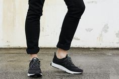 Black jeans and New Balance sneakers