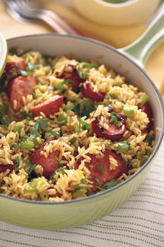Skillet Sausage 'n' Rice - Quick-Fix Rice Suppers - Southernliving. Recipe: Skillet Sausage 'n' Rice This dish truly can be made quickly. It begins with a pound of smoked sausage, and a couple of bags of quick-cooking brown rice do the trick for this easy dish. Toss in a chopped bell pepper, a small onion, some garlic, and some chicken broth, and you'll be amazed with how simple this dish really is. You will love how the flavors all tie together, and how delicious it all is. Smoked sausage…