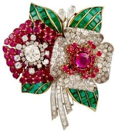 Circa 1930's Tri-Color Diamond,Ruby & Emerald Flower Brooch. Platinum, 18kt. Yellow & Pink Gold Diamond, Ruby & Emerald Flower Brooch. Via 1stdibs.