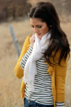 Rachel Parcell wears a tried and true combo: blue and white stripes, jeans and mustard cardigan...it's a casual, fun, and youthful oufit.