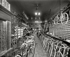 "Detroit, Michigan, circa 1912. ""Metzger bicycle shop. Detroit City Gas Co."" This photo of a cycle (and phonograph) shop was taken to show off the gaslight fixtures."