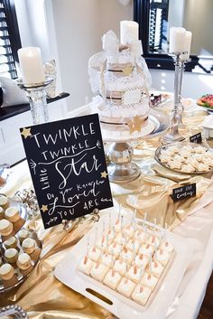 The dessert table will be shining like a diamond in the sky with tasty desserts and a cute diaper cake. | A Twinkle Twinkle Little Star Dessert Table | 7 Twinkly Inspirations for a Wish Upon A Star Baby Shower
