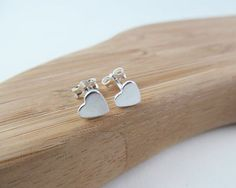 This pair of heart studs in silver are 100% hypoallergenic and nickel free so that your heart studs will be comfortable to wear all day, every day.  The perfect first pair of stud earrings for a little girl, or for women who love minimal jewelry. Heart Studs Silver Heart Studs Little Girl Jewelry Earrings 925 Silver by NikkiHillsDesign
