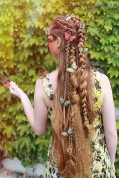 This whimsical look was achieved by incorporating various braids that transition into each other. It would look great paired with a fairy costume this Halloween.