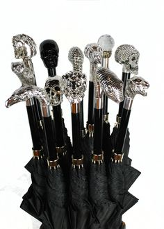 Archer Adams Westminster Gothic Umbrellas. They come in Horse, Owl, Serpent, Skull, Swarovski Crystal Ball, Eagle, Bull Dog, Jaguar, Labrador, Lion, Lizard Skin, Toucan, Frog, Duck, Greyhound, 'Damien' Crystal* and Carbonised Black Skulls. This should make for a more interesting rainy day.