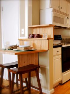 DIY shows you a low cost and easy way to add a breakfast bar to your kitchen with a hinged folding tabletop and stools.