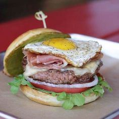 GREEN EGGS & HAM Burger Special: Beef Patty, Prosciutto, Manchego Cheese, Fried Egg, House-made Salsa Verde, Arugula, Tomato, Onions, Egg Bun