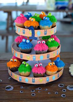 Monster Cupcakes. Use frosting to put google eyes on gum balls for the eyes. Super cute!!!