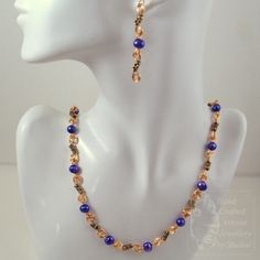 SOLD! Purple dyed freshwater pearls and antique gold finish beads on a handmade gilt plated copper wire chain. Very glamorous! Perfect Evening wear!    Necklace Length: 19 inches    Earrings: 2.5 inches from top of the ear-wire. Ear wires are made from 14/20 Gold Fill wire. £22.00