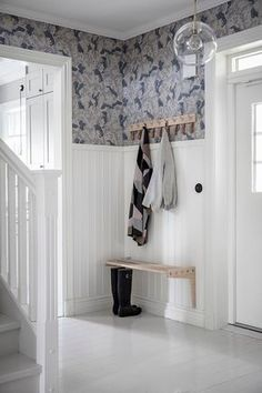 Modern entryway with white beadboard and fun wallpaper. Wooden hook and simple bench make this entryway simple and stylish. Wood Interior Design, Home Interior, Interior And Exterior, Interior Decorating, Hallway Inspiration, Interior Inspiration, White Beadboard, Entry Hallway, Scandinavian Home
