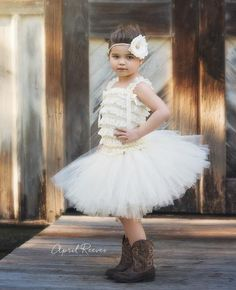 There is nothing more adorable on a little princess than ruffles and a tutu! The Madison ivory tutu dress set includes a soft stretchy ruffly top, a very full tutu skirt and a sweet flower headband an