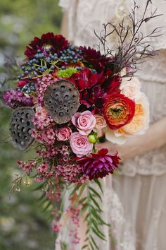 Fall/winter bouquet with lotus pods, roses, ranunculi, and other beautiful blooms