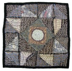 Moon Star with border by Morna Crites-Moore.  Beautiful hand stitching.