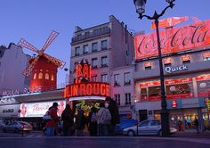 Coca Cola sign next to the Moulin Rouge, Paris by Thierry B on Flickr.