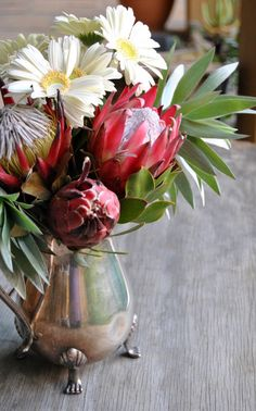 Proteas, gerberas and silver leaves