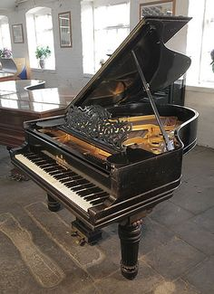 An unrestored, 1898, Steinway Model A grand piano for sale with a black case, filigree music desk and fluted, barrel legs at Besbrode Pianos. Piano has an eighty-five note keyboard and a two-pedal lyre.