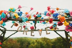 Pop Colors, Balloons, Crepe Paper Flowers and Pom Poms for the Ceremony Exit