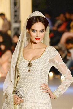 04cc409081 A model presents a creation by designer Zara Shahjahan during the Pakistan Fashion  Design Council (