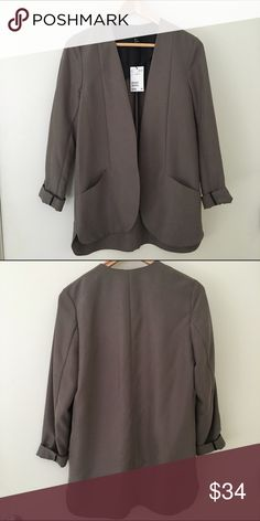 Charcoal grey / taupe h&m blazer (NWT!) New with tags! Charcoal grey/taupe h&m blazer. 67% modal; 33% polyester. Very soft and can be dressed up or down. Great as workwear paired with a dress or pants. H&M Jackets & Coats Blazers