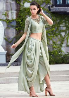 Yellow Crop Top Matched With Fancy Dhoti Pant And A Full Length Floral Jacket Online - Kalki Fashion : Laurel Green Crop Top In Raw Silk With Dhoti Pants And Long Embroidered Jacket Online - Kalki Fashion Party Wear Indian Dresses, Indian Gowns Dresses, Indian Fashion Dresses, Dress Indian Style, Indian Wedding Outfits, Indian Designer Outfits, Indian Outfits, Designer Dresses, Indian Clothes
