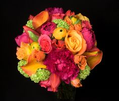 This is an arrangement featuring orange ranunculus, pink peonies, orange roses and green viburnum.  See our entire selection at www.starflor.com.  To purchase any of our floral selections, as gifts or décor, please call us at 800.520.8999 or visit our e-commerce portal at www.Starbrightnyc.com. This composition of flowers is generally available for same day delivery in New York City (NYC). SP012