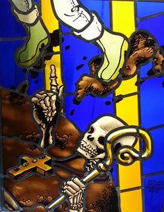 Stainedglass designed by dutch cartoon artist Theo van den Boogaard made by atelier Schmit  for bakenesserkerk Haarlem